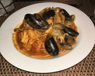 Seafood Spaghettini with fresh shrimp, scallops, mussels, cockles, and calamari